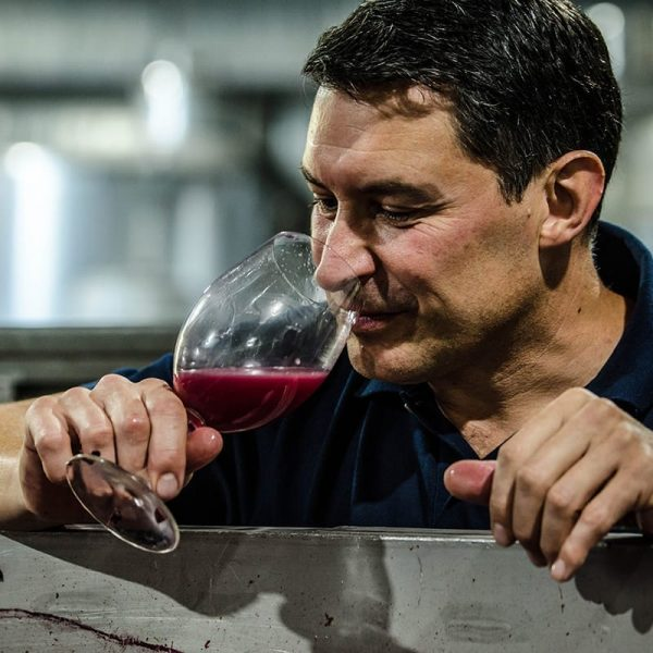 Winemaker Scott Heidrich tasting a red wine