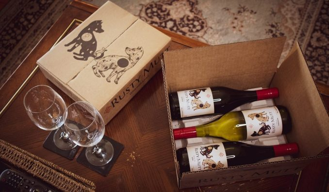 opening a case of Rusty Mutt Wines